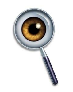 eye behind a magnifying glass, keyword search
