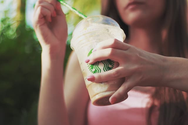 Girl drinking starbucks drink
