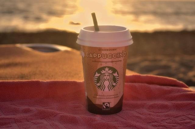 starbucks cup on beach